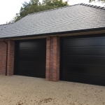 d-ribbed sectional garage doors in black